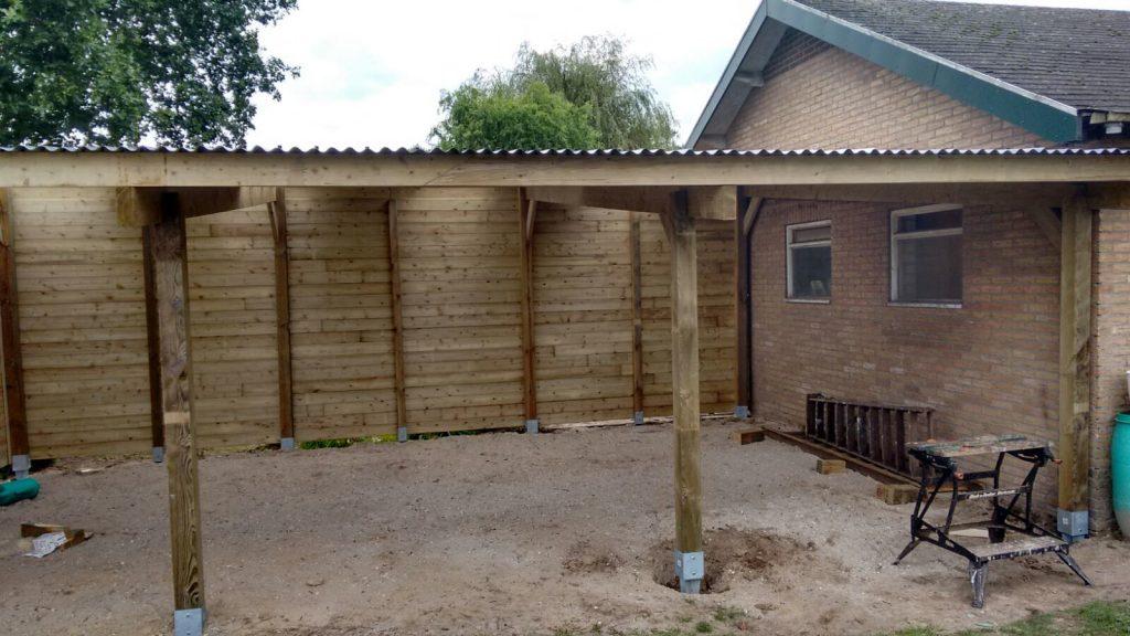 Prefab afdak bouwpakket bouw zelf een houten afdak for Zelf woning bouwen prijzen